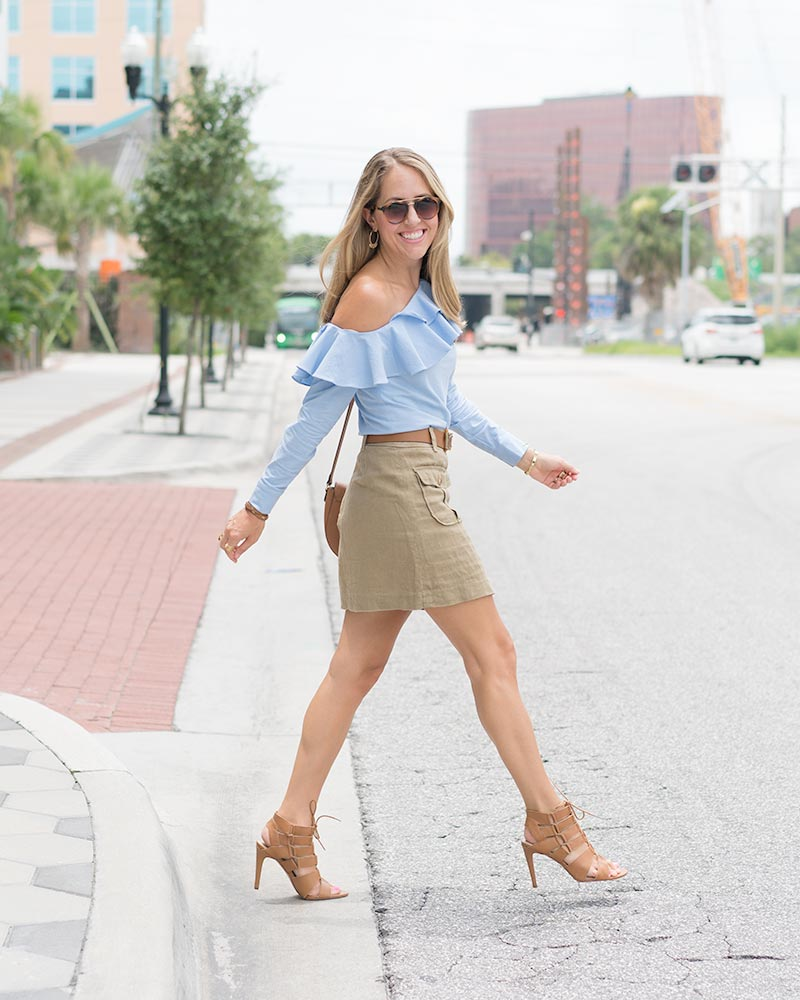 Blue ruffle top, military skirt