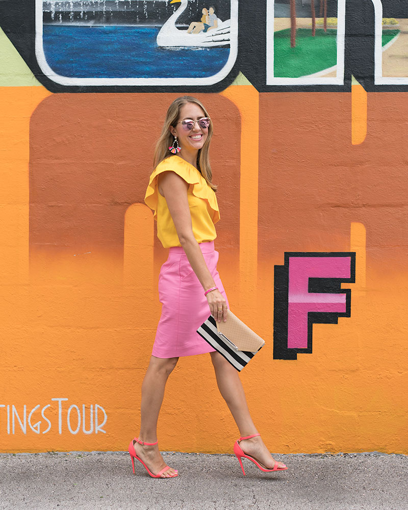 Yellow ruffle top, pink pencil skirt, stripe clutch