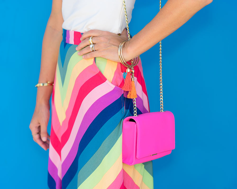 Colorful outfit: rainbow skirt, pink purse
