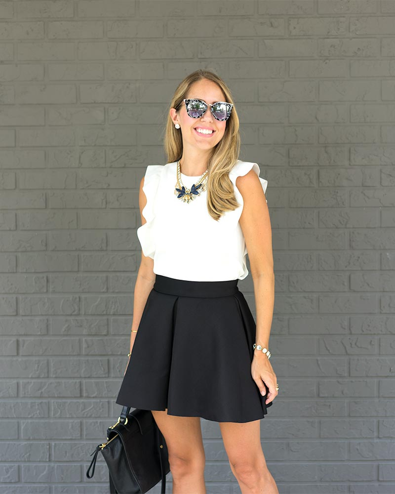 White ruffle top, Monroe statement necklace, black skater skirt