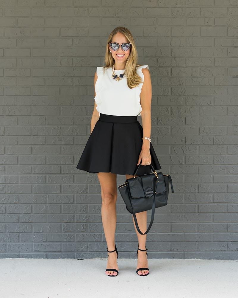White ruffle top, black skater skirt