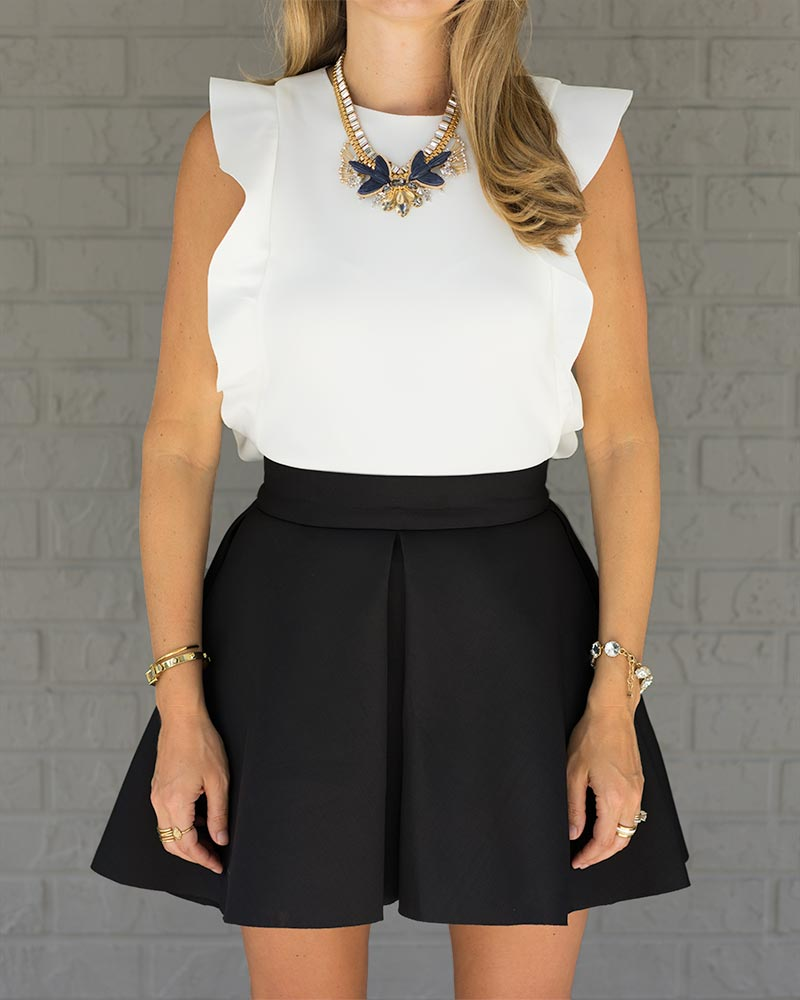 Black and white outfit, ruffle top, Monroe statement necklace, skater skirt