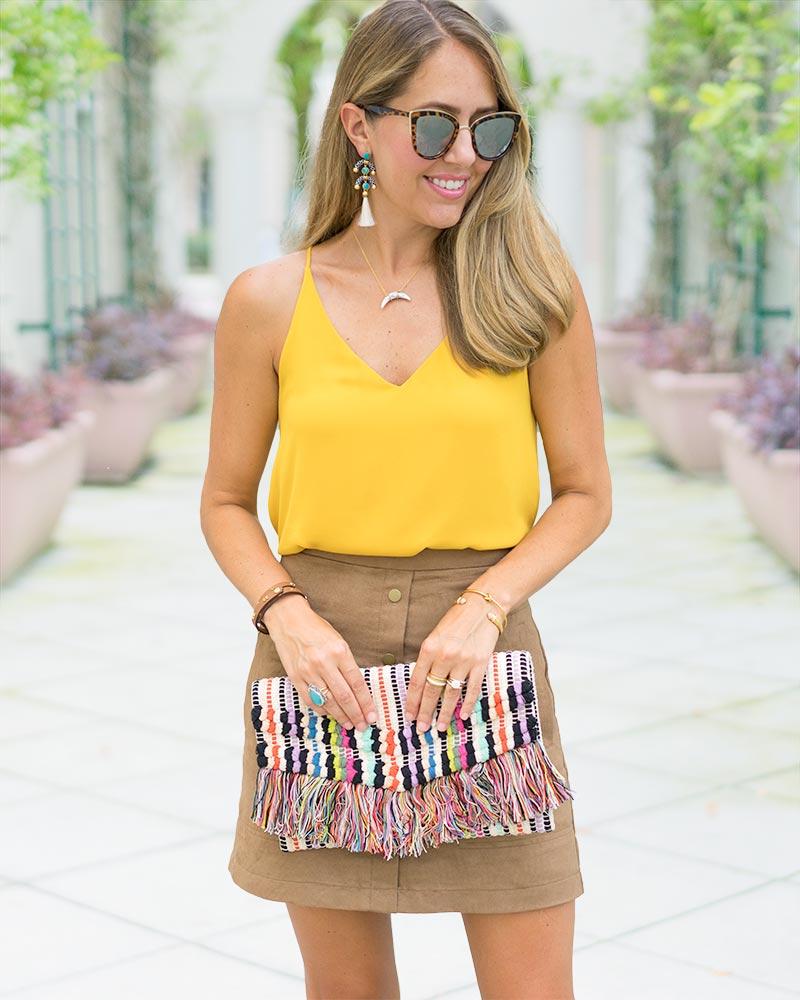 Suede skirt, mustard top, Taj fringe clutch