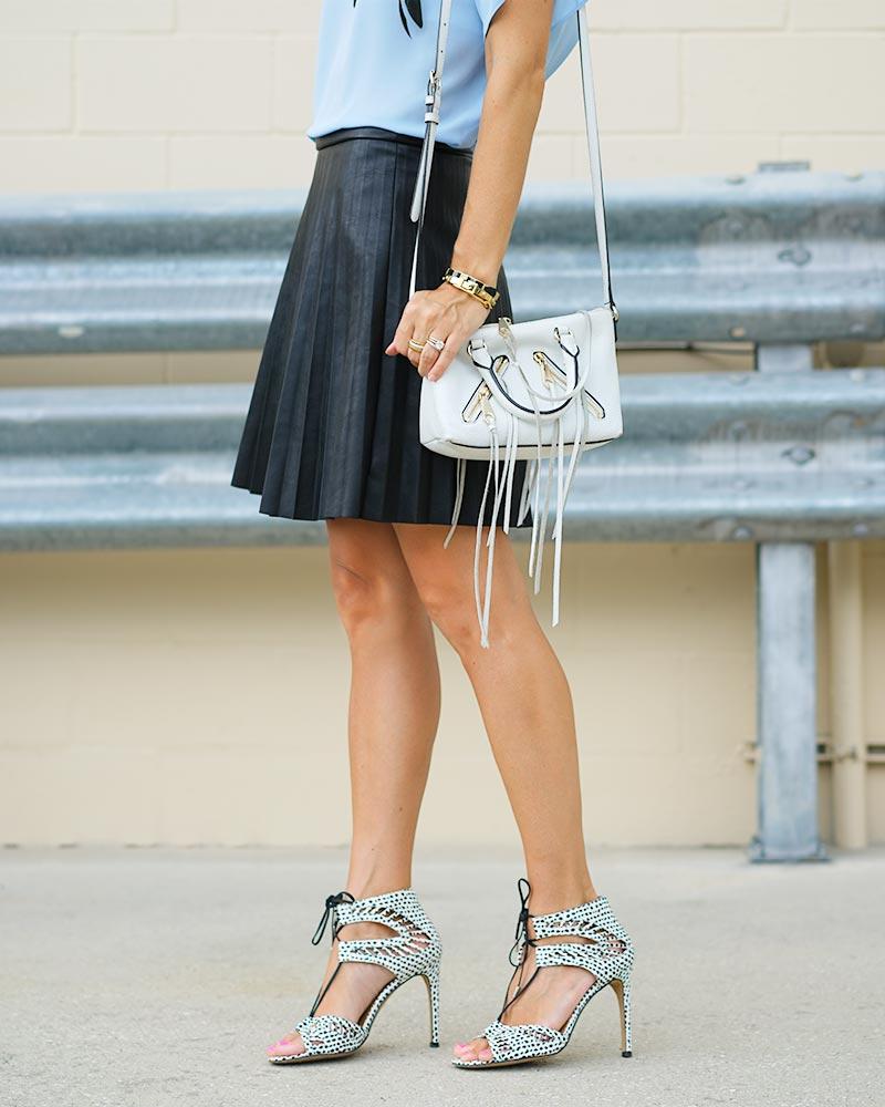 pleated leather skirt, white fringe purse, dalmatian heels