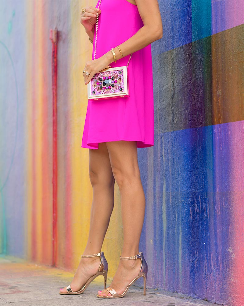 Neon pink dress, jeweled clutch, rose gold