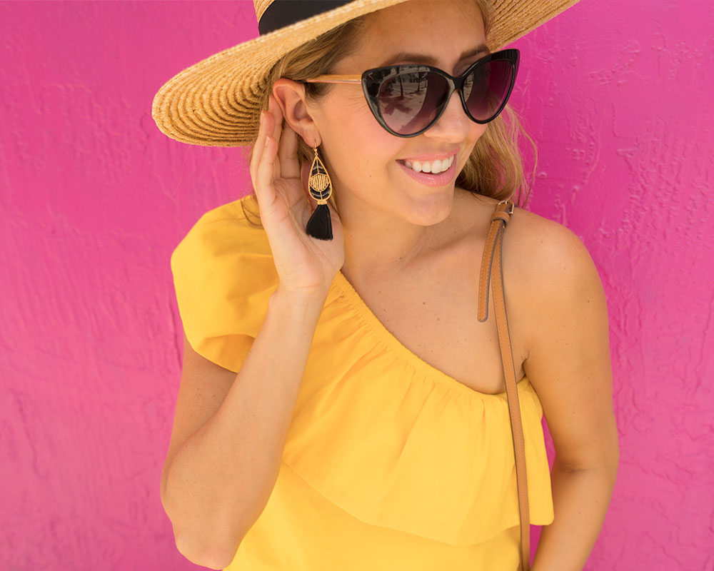 Yellow one shoulder top, black feather earrings
