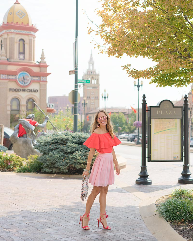 Red off the shoulder, pink pleated skirt