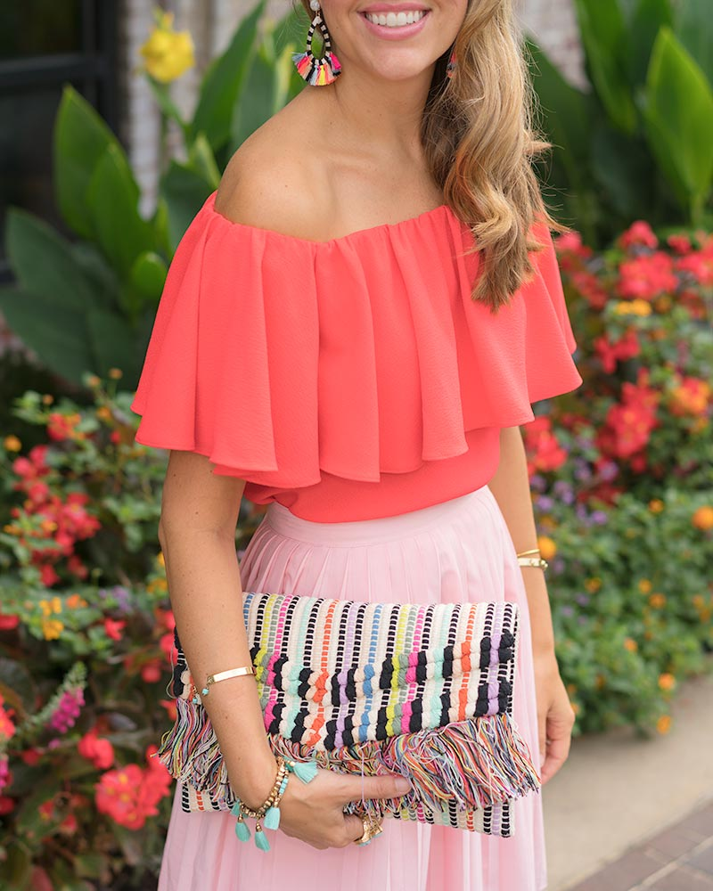 Red off the shoulder, pink pleated skirt, Taj clutch