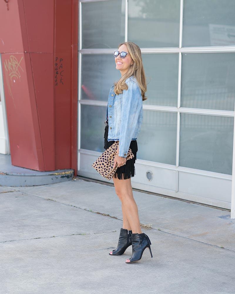 Fringe skirt, denim jacket, leopard clutch