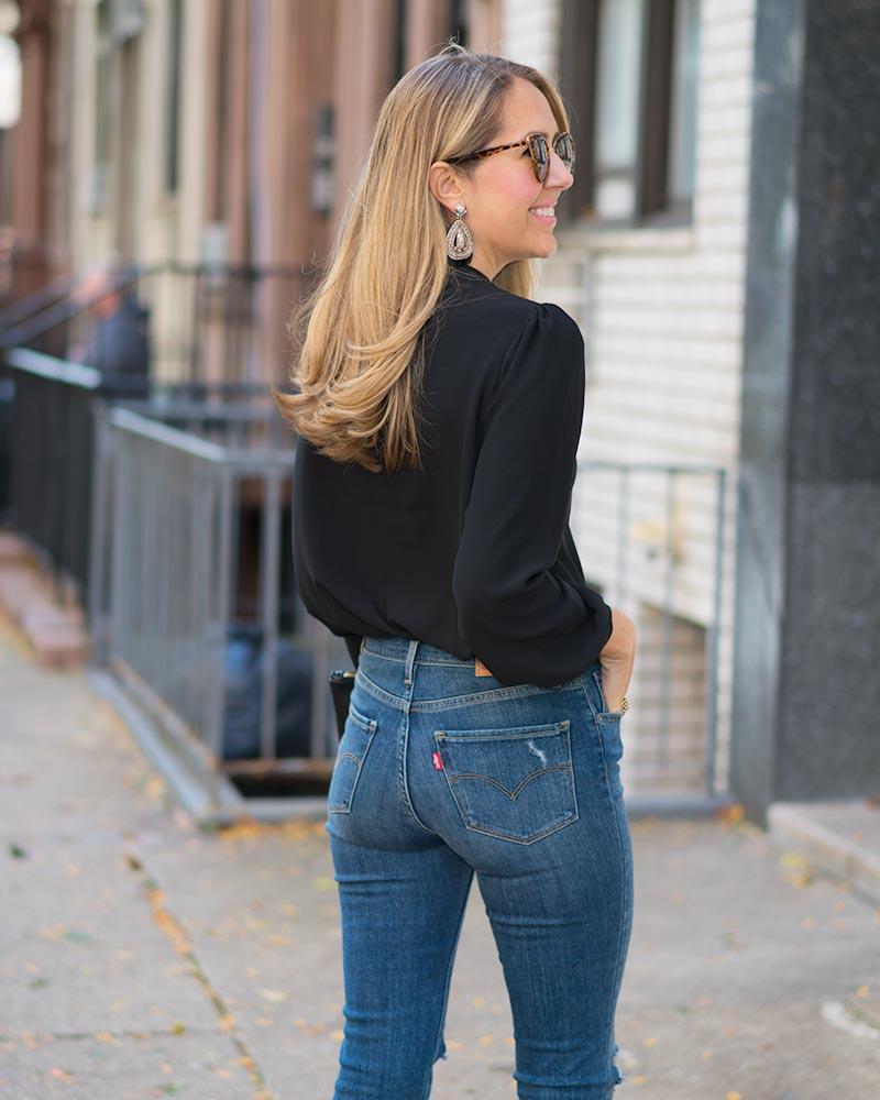 Choker top, statement earrings, high waist jeans