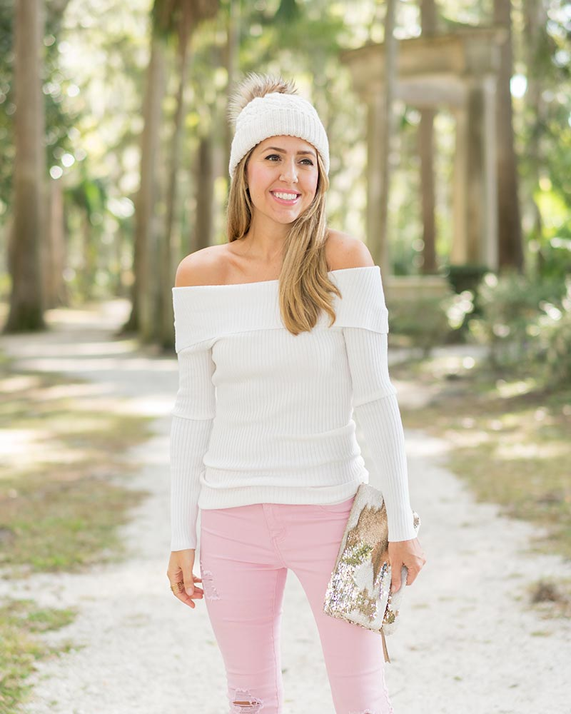 Pink jeans, off shoulder sweater, sequin clutch, beanie