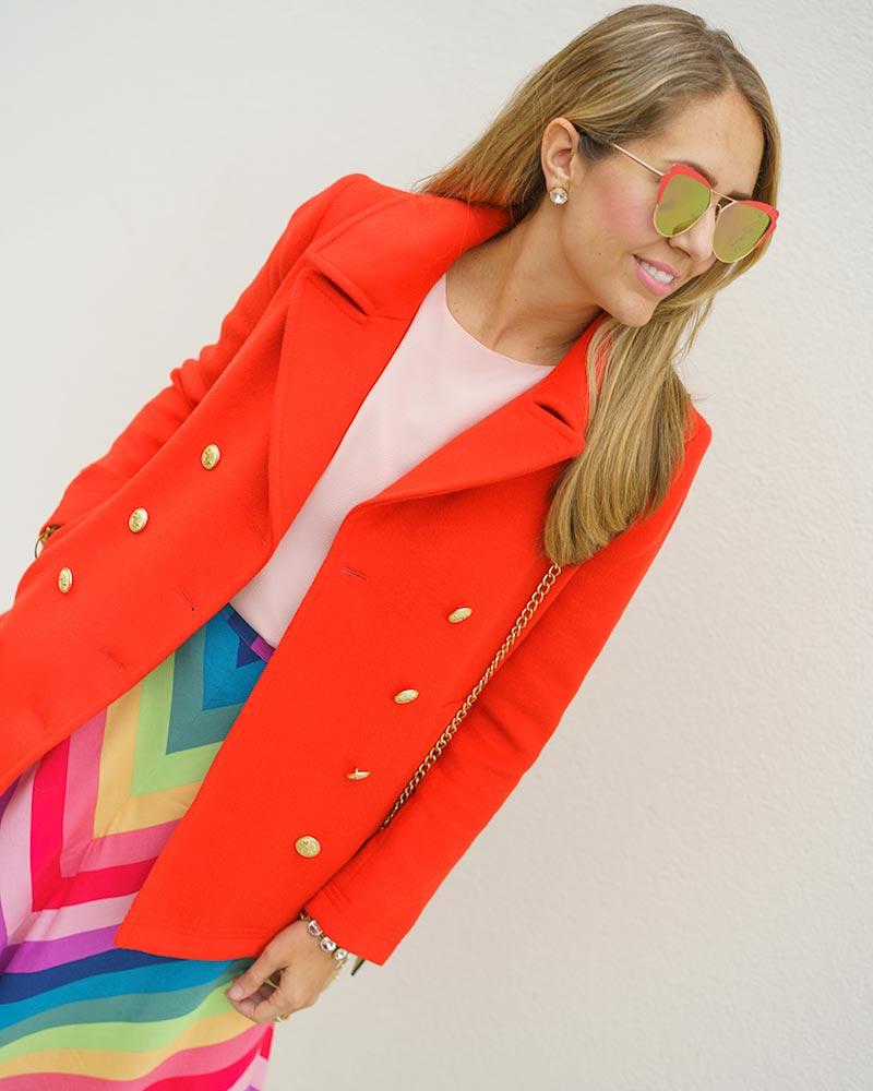 Red coat, rainbow skirt