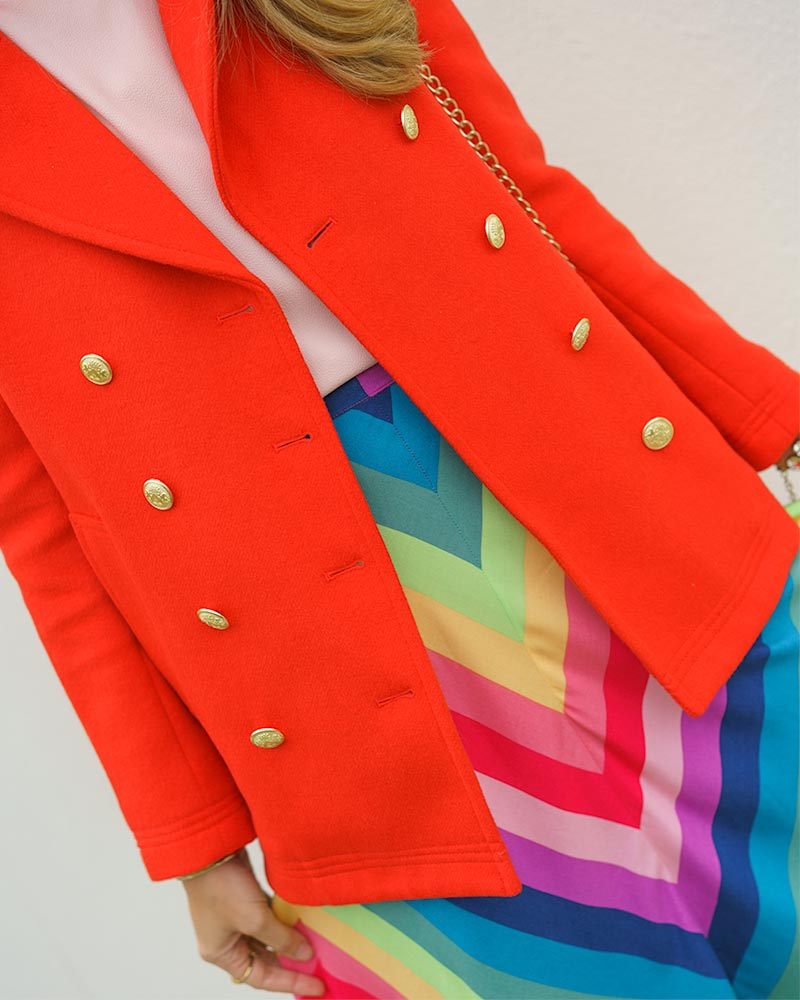 Red coat, rainbow skirt