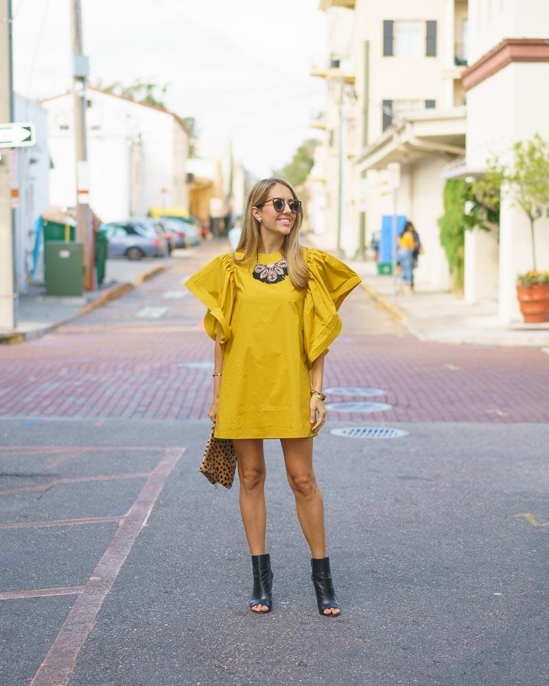 Yellow ruffle sleeve dress, leopard clutch