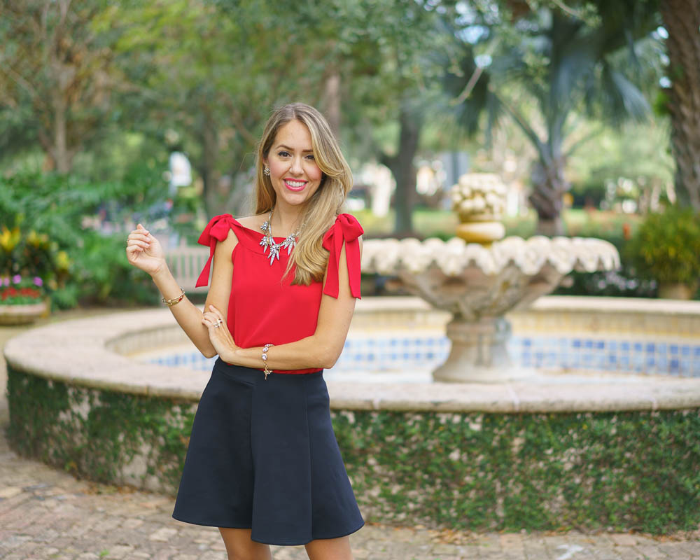 Red top, black skirt holiday outfit