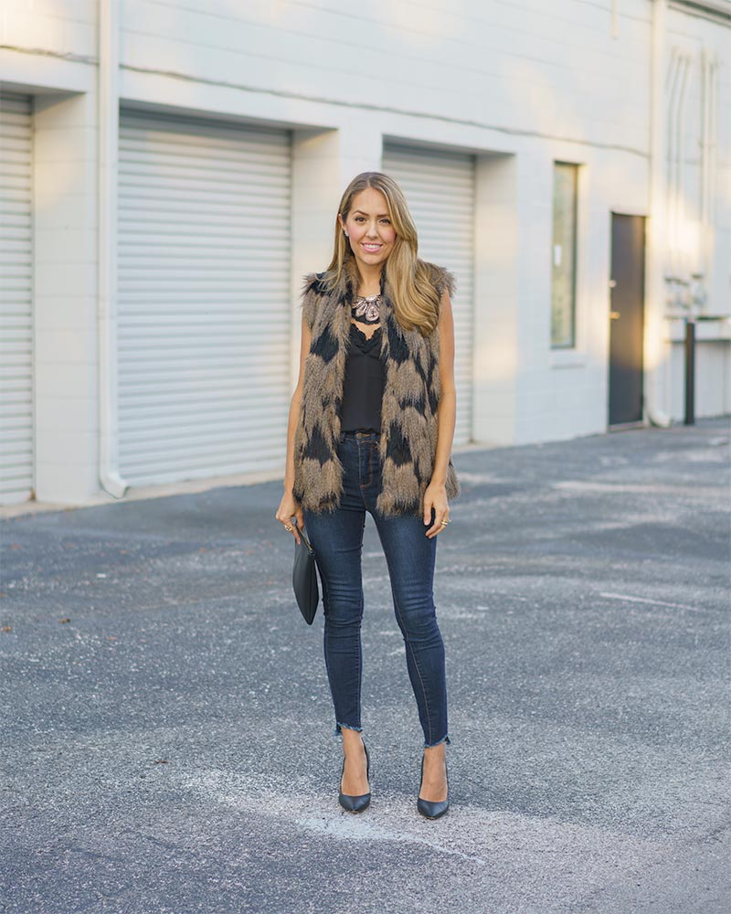 Faux fur vest, skinny jeans, statement necklace