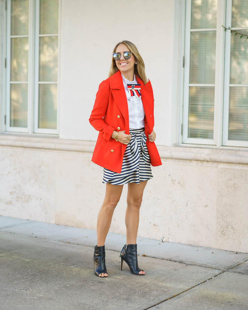 Red white blue outfit: red coat, stripe skirt