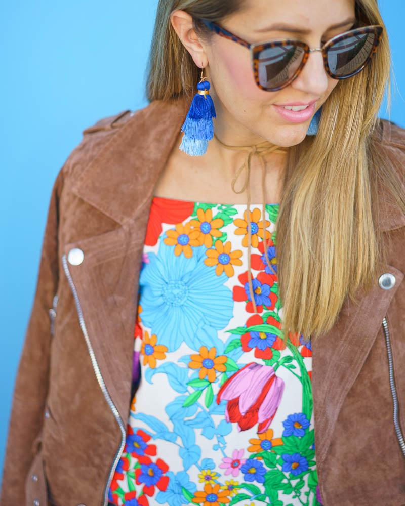 Suede jacket, tassel earrings, floral print
