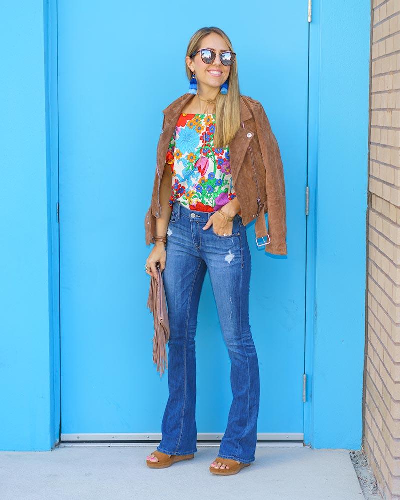 70s style: suede jacket, tassel earrings, floral print