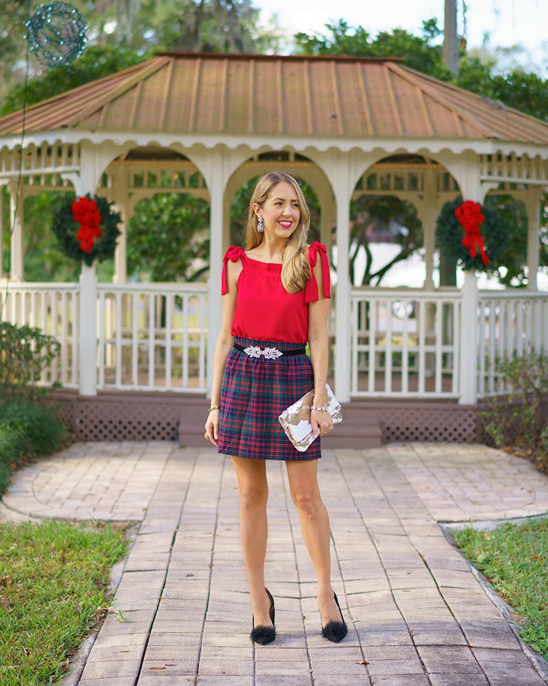 Red bow top, plaid skirt, jeweled velvet belt