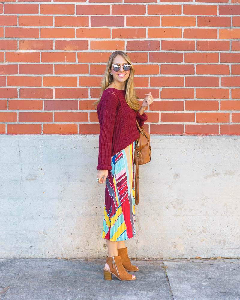 Colorful winter outfit: pleated skirt, burgundy sweater