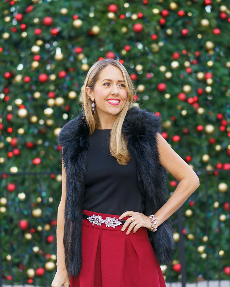 Christmas outfit: faux fur vest, red skirt