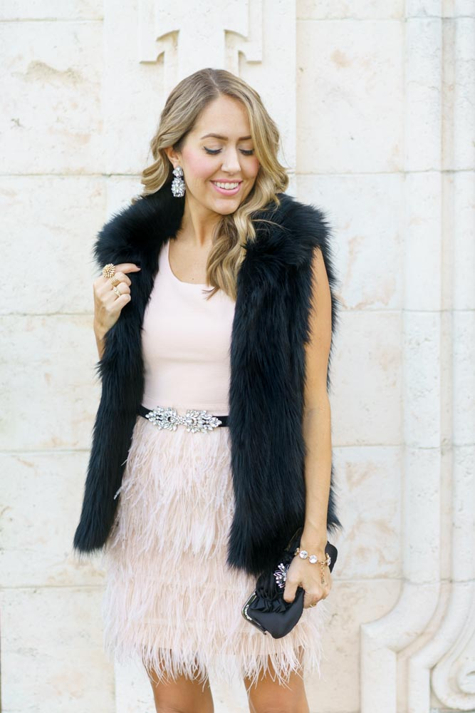 Pink feather dress and black faux fur vest for ballet