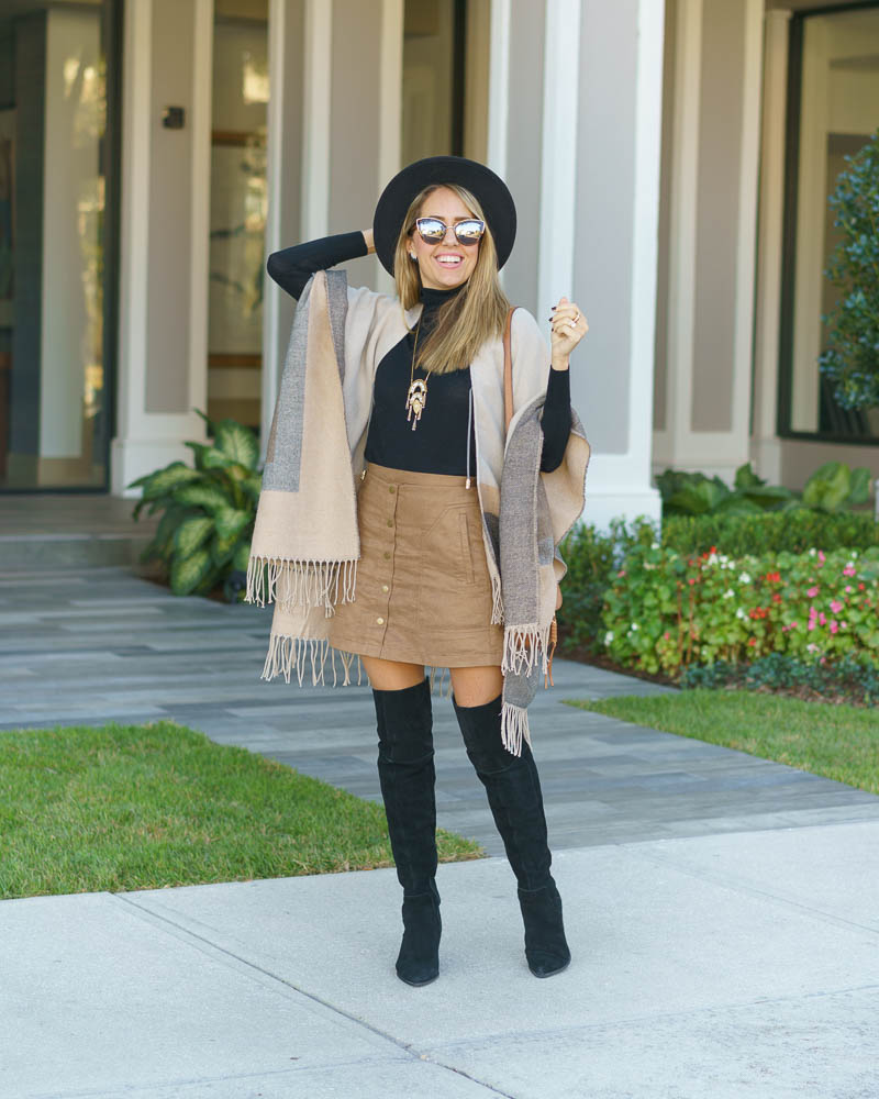 Poncho, over the knee boots, suede skirt