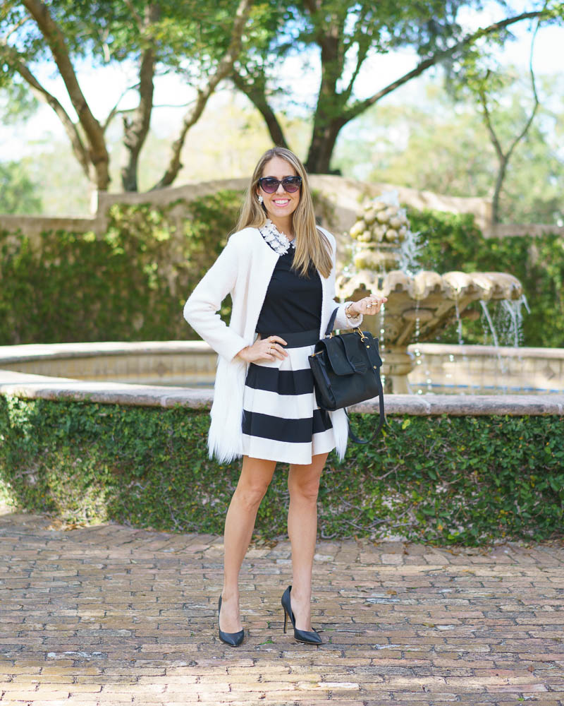 Embellished collar top, white coat, stripe skirt