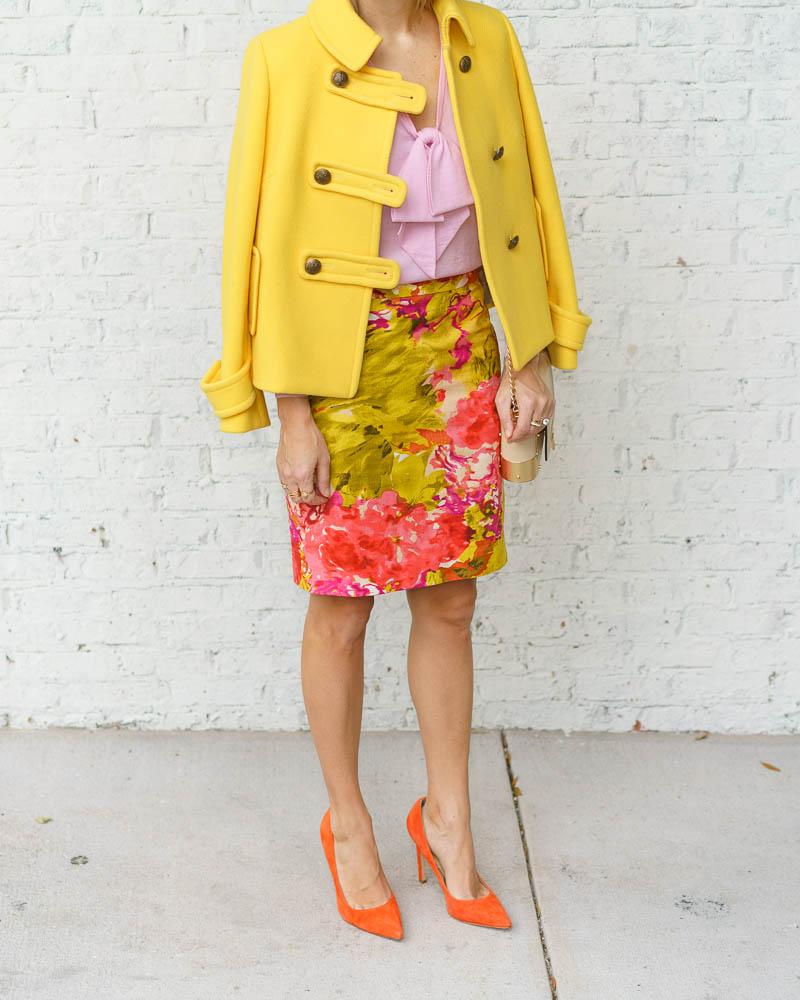 Yellow coat, pink sweater, floral skirt, orange heels