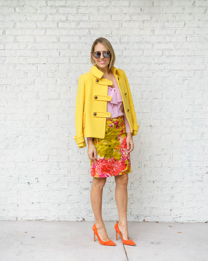Yellow coat, pink sweater, floral skirt, orange heels