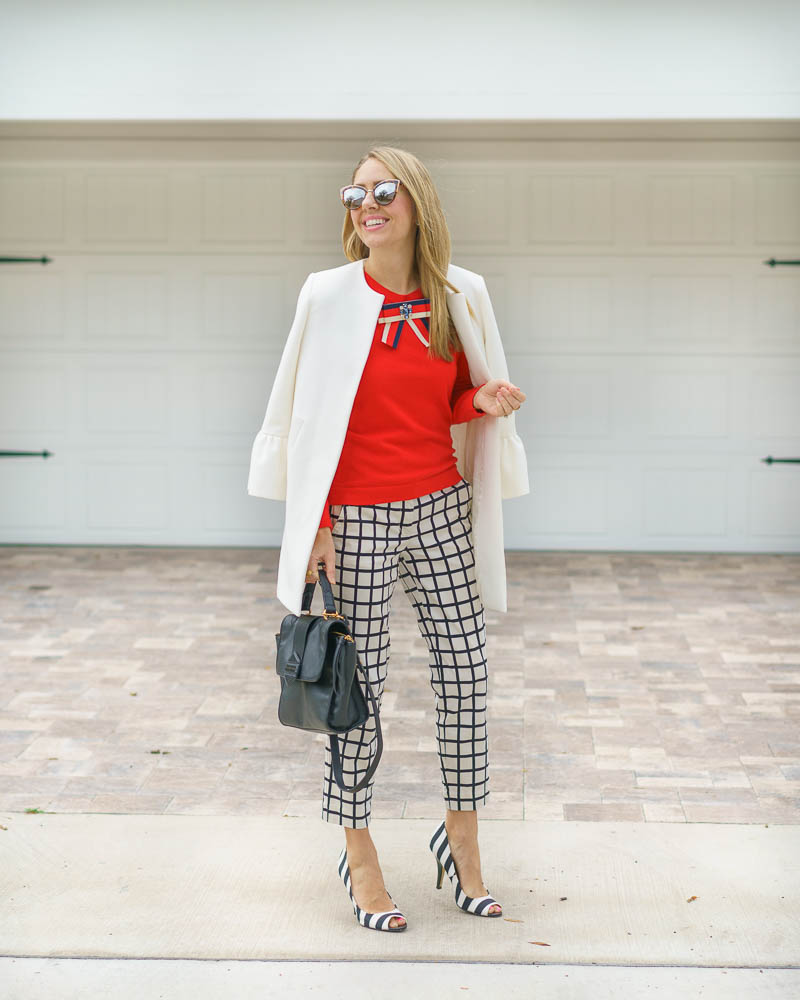 Red sweater, windowpane pants, stripe heels