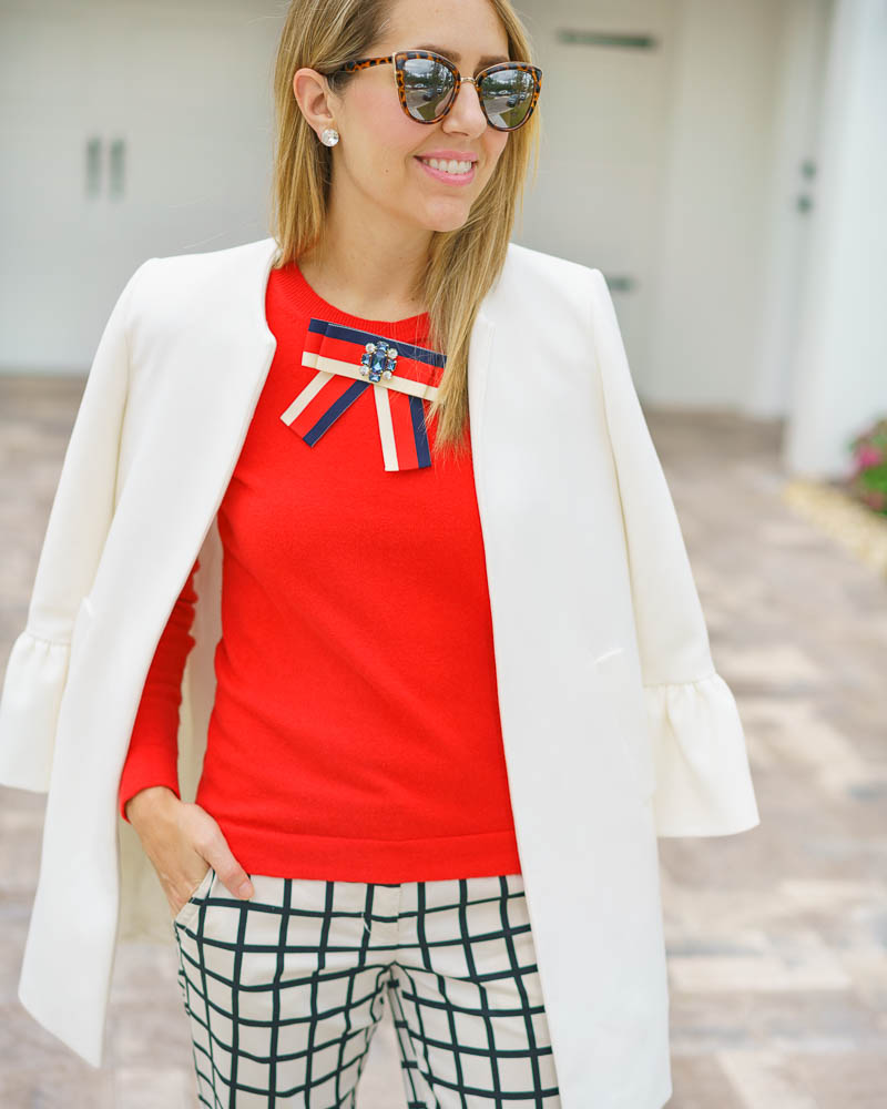 Red sweater, windowpane pants, white coat