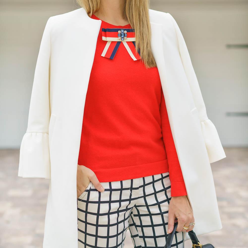 Red sweater, windowpane pants, white coat