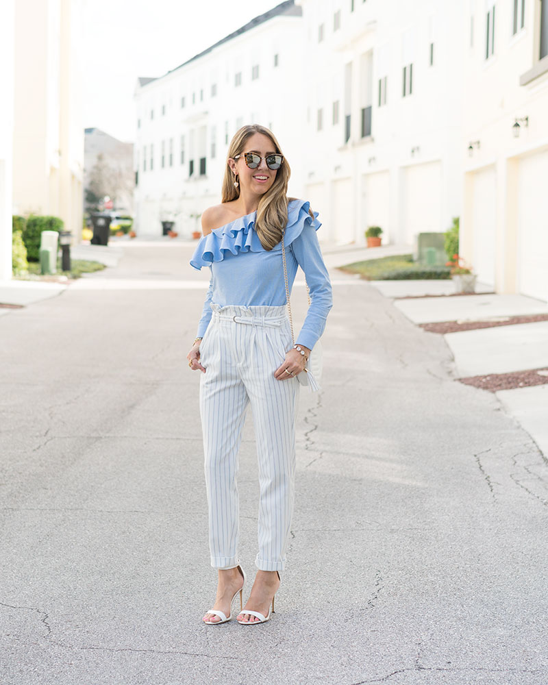 Blue ruffle top, white high waist dress pants
