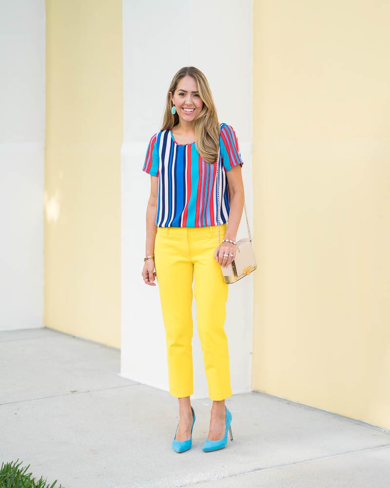 Rainbow stripe top, yellow pants, blue heels