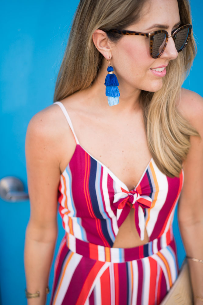 Red stripe jumpsuit, blue tassel earrings