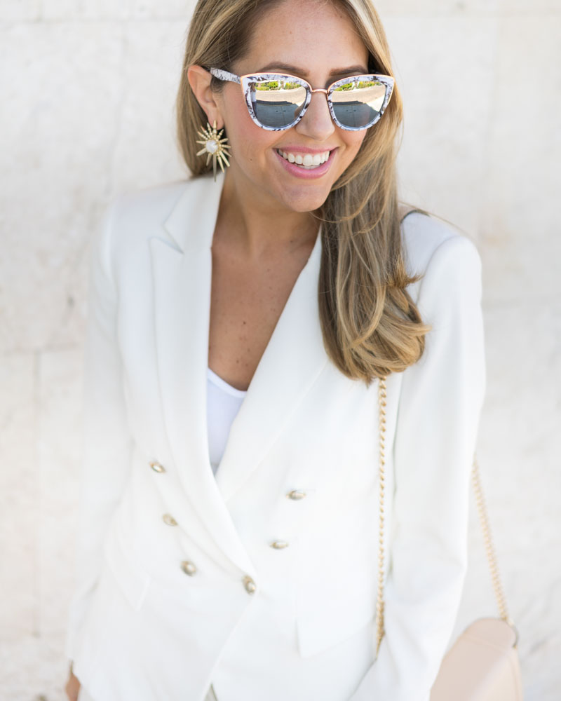White suit, star earrings