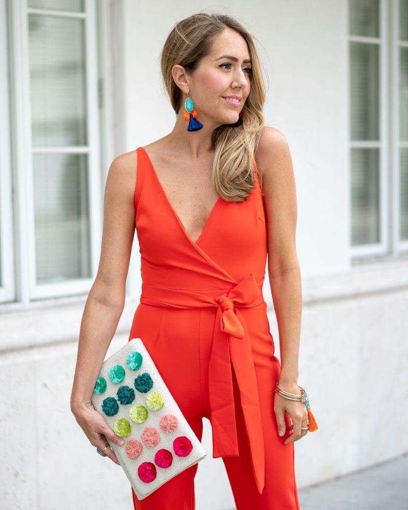 Orange red jumpsuit, pom pom clutch