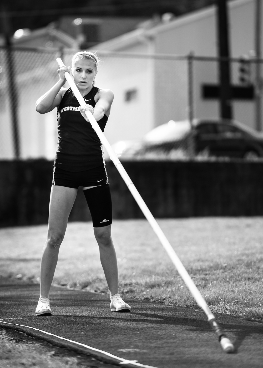 pole vaulter ready position track and field meet college