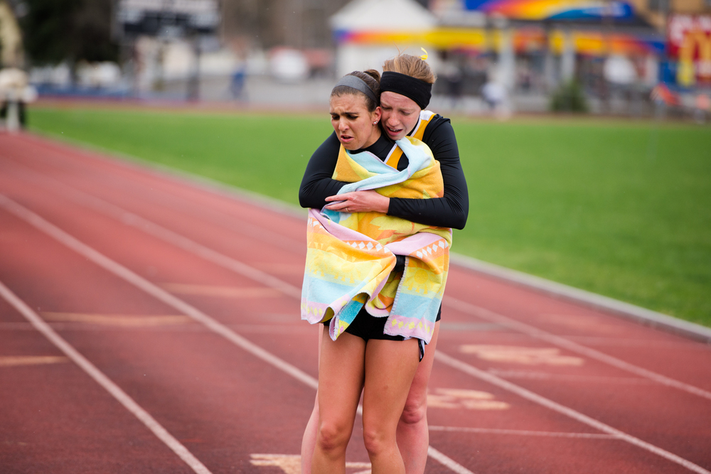 Two Geneva runners commiserate together after completing the steeplechase event.