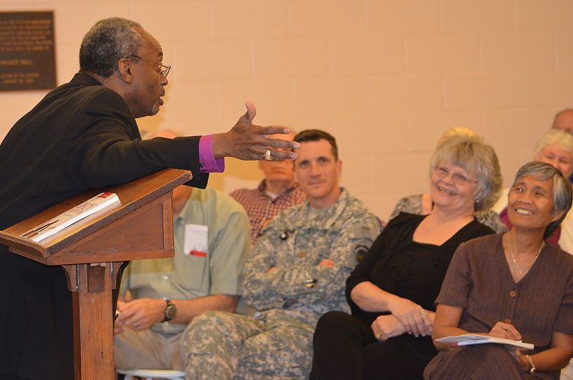 bishop curry rivets attendees at the st. john's speaker series as he explains we all NEED to be crazy christians.