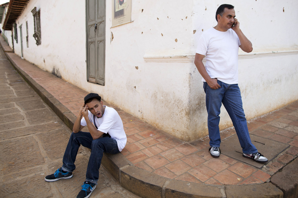 Barichara. 28 July 2012. Felipe and his stepfather Jose taking a break during a trip to the small town of Barichara.