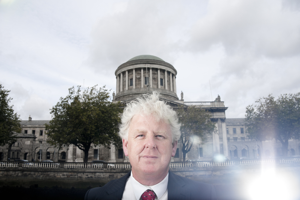 Lawyer and writer  Michael O'Higgins  in front of the Four Courts in Dublin.  Photographed for the   The Irish Independent  .