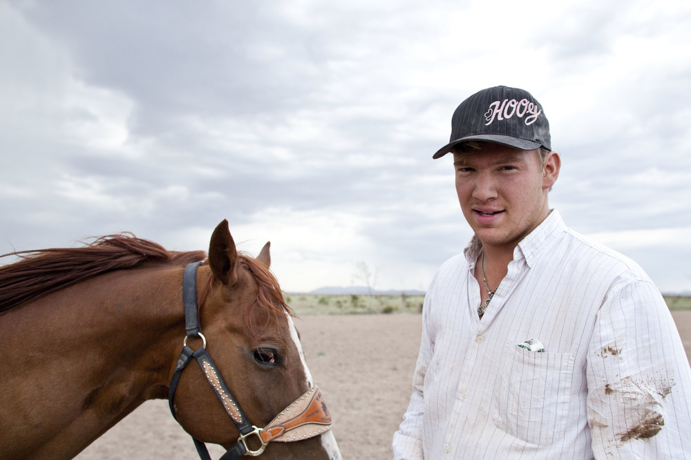 USA. Texas. Marfa. August 2013. 17-year-old Walker Kibbe after having wrestled a steer.