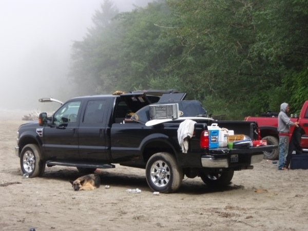 Kaiser guards the truck on a camping trip to Neah Bay