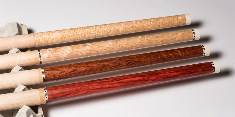 All four of these cues have been sold.