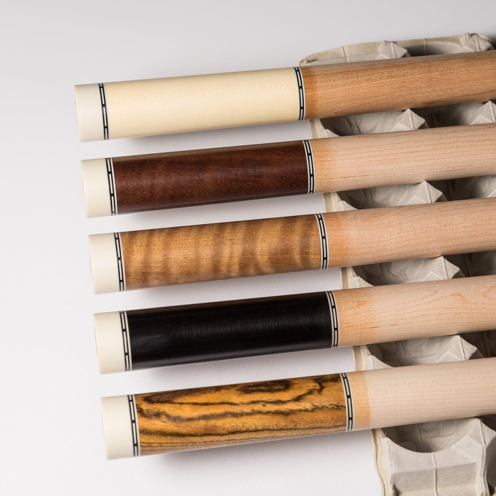 Pictured from top to the bottom: holly, wenge, asian satinwood, ebony, and bocote.