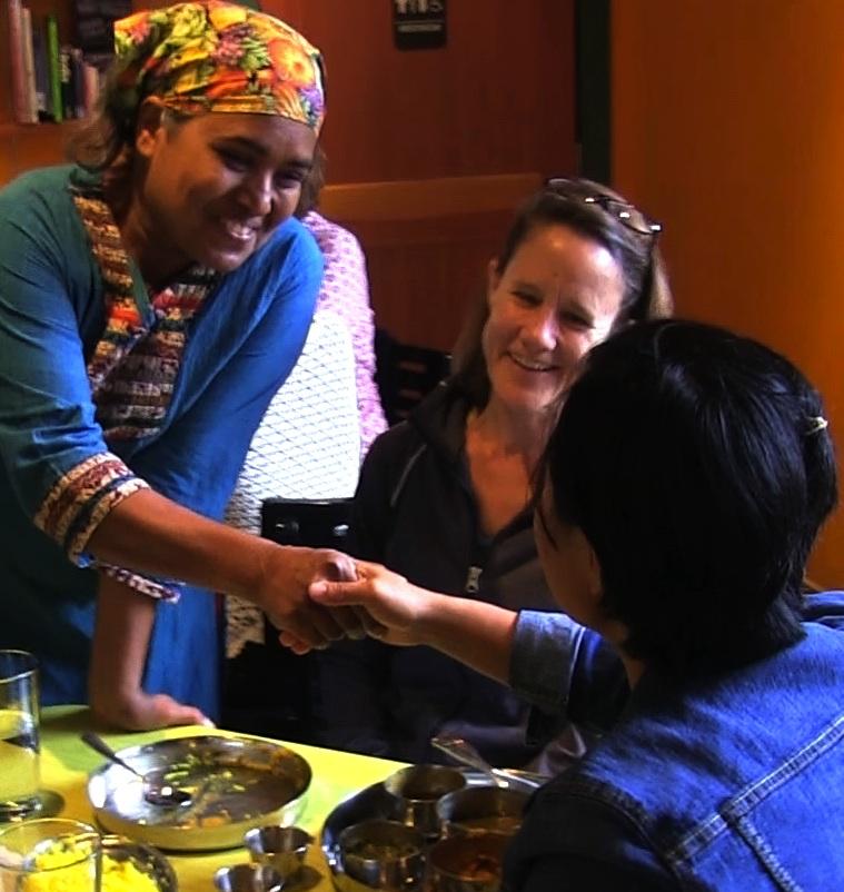 Crop.Vimala Handshake in Restaurant.jpg