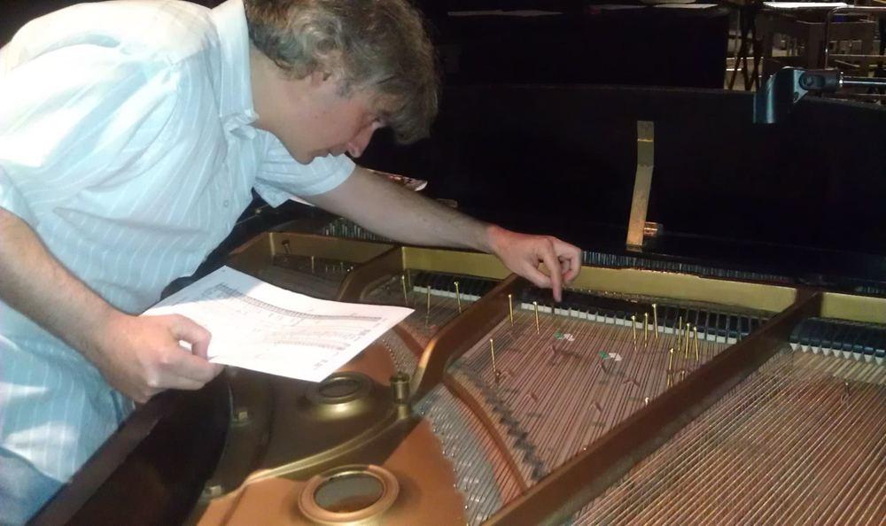 Preparing the piano for the John Cage Festival at FSU